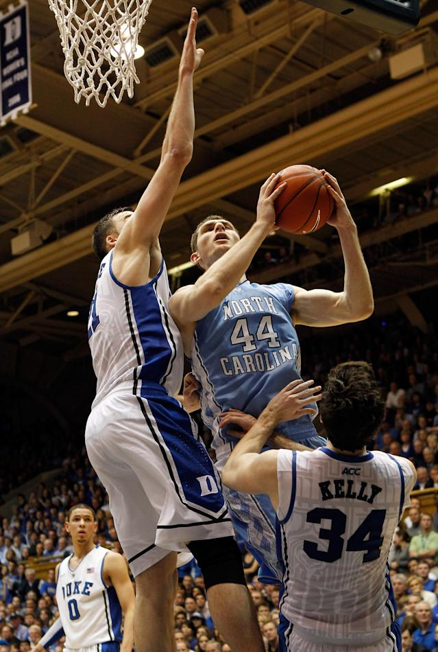 DURHAM, NC - MARCH 03: Miles Plumlee #21 of the Duke Blue Devils and teammate Ryan Kelly #34 try to stop Tyler Zeller #44 of the North Carolina Tar Heels during their game at Cameron Indoor Stadium on March 3, 2012 in Durham, North Carolina. (Photo by Streeter Lecka/Getty Images)