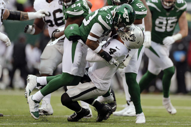 FILE- In this Nov. 24, 2019, file photo, New York Jets strong safety Jamal Adams (33) sacks Oakland Raiders quarterback Derek Carr (4) during the first half of an NFL football game in East Rutherford, N.J. The Jets traded disgruntled star safety Adams to the Seattle Seahawks on Saturday, July 25, 2020, splitting with a gifted player whose relationship with the franchise quickly deteriorated because of a contract dispute. (AP Photo/Adam Hunger, File)