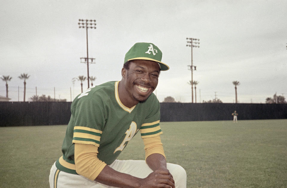 FILE - This 1975 file photo shows Herb Washington, an outfielder for the Oakland Athletics. Washington, The Black owner of 14 McDonald's franchises in Ohio has sued the corporation in federal court asserting numerous instances of unfair treatment compared with white owners. Washington in his lawsuit filed Tuesday, Feb. 16, 2021 says the Chicago-based company has steered him over the years into buying franchises in low-income, majority Black communities while denying him the chance to buy stores in more affluent white locations. (AP Photo/Robert Houston, File)