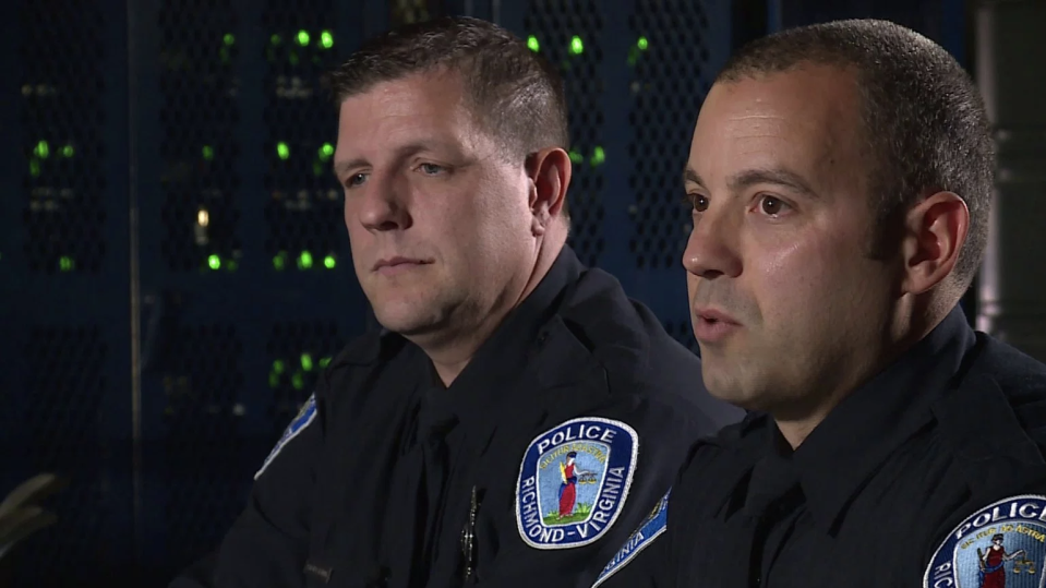 Officers Aaron Henning, left, and Daniel Raines reflect on the incident that led to their receiving a Valor Award. (Photo: WTVR)