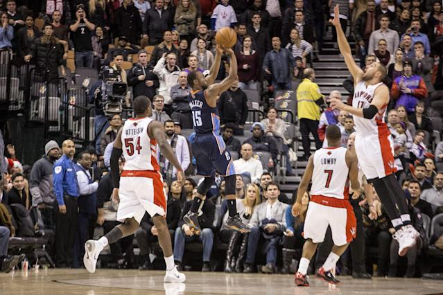 Charlotte Bobcats' Kemba Walker goes up for a basket at the buzzer in overtime that gave the Bobcats a 104-102 win over Toronto Raptors in NBA basketball game in Toronto on Wednesday, Dec. 18, 2013. (AP Photo/The Canadian Press, Chris Young)