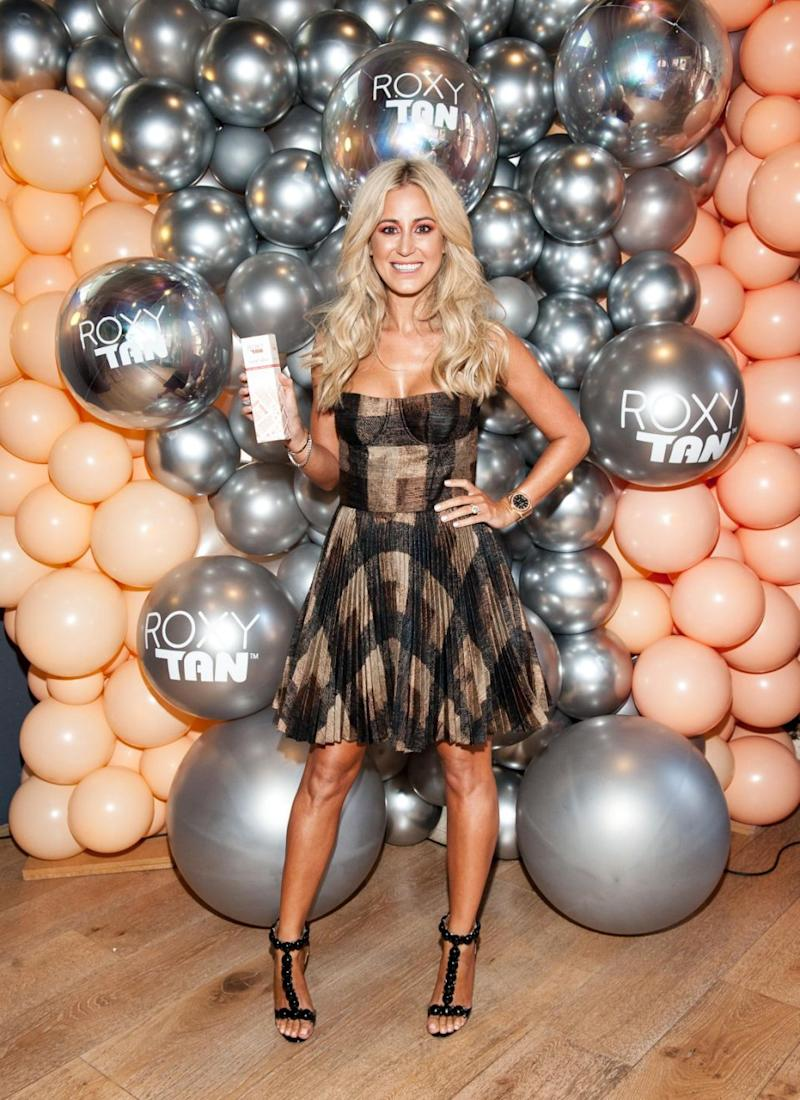 The blonde beauty looked stunning in a bronze, gold and black mini dress showing off her glowing skin at the launch event. Source: Supplied