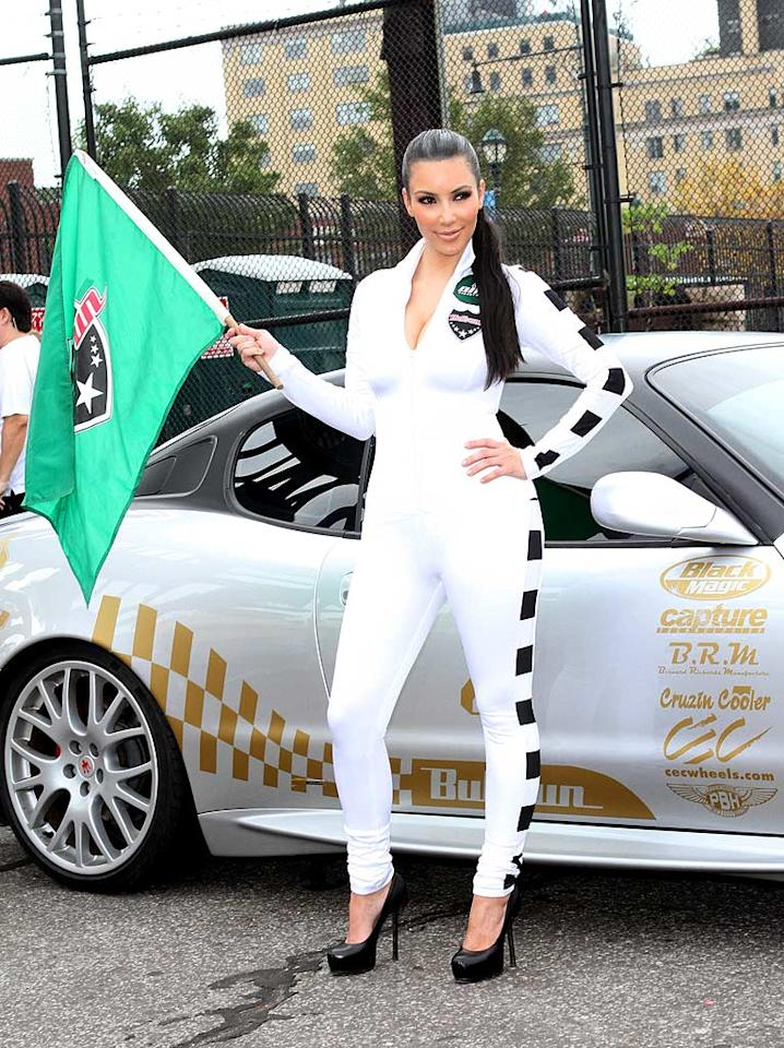 """Another fan of unsightly jumpsuits is sultry socialite Kim Kardashian, who paraded around in this tacky white atrocity, along with outdated Yves St. Laurent platform pumps, while emceeing the annual Bullrun Rally in NYC. Richie Buxo/<a href=""""http://www.splashnewsonline.com"""" target=""""new"""">Splash News</a> - July 10, 2010"""