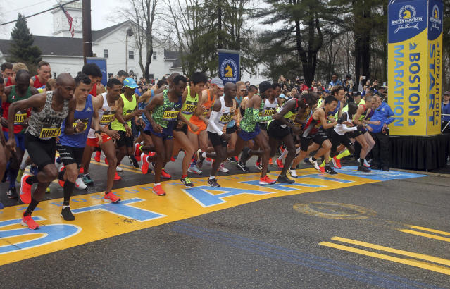 FILE - In this April 15, 2019, file photo, the elite men break from the start of the 123rd Boston Marathon in Hopkinton, Mass. The Boston Marathon is offering refunds for the first time because of the new coronavirus pandemic. Race organizers say anyone who was entered in the 124th edition of the race this month can still run on the rescheduled date, Sept. 14. But if they can't make it, they can have their money back. (AP Photo/Stew Milne, File)