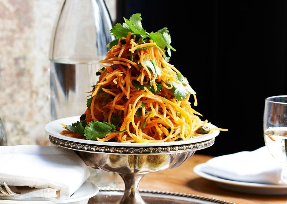 "Using your food processor's shredding blade makes this simple bistro salad a very doable weeknight option. <a href=""https://www.bonappetit.com/recipe/carrot-salad-with-coriander-vinaigrette-and-pistachios?mbid=synd_yahoo_rss"" rel=""nofollow noopener"" target=""_blank"" data-ylk=""slk:See recipe."" class=""link rapid-noclick-resp"">See recipe.</a>"