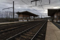 """An empty platform is pictured during a railway strike at the Saint Germain au Mont d'Or train station, around Lyon, central France, Monday, Dec. 9, 2019. French commuters inched to work Monday through exceptional traffic jams, as strikes to preserve retirement rights halted trains and subways for a fifth straight day. Citing safety risks, the SNCF national rail network issued warned travelers to stay home or use """"alternate means of locomotion"""" to get to work Monday instead of thronging platforms in hopes of getting the few available trains. (AP Photo/Laurent Cipriani)"""
