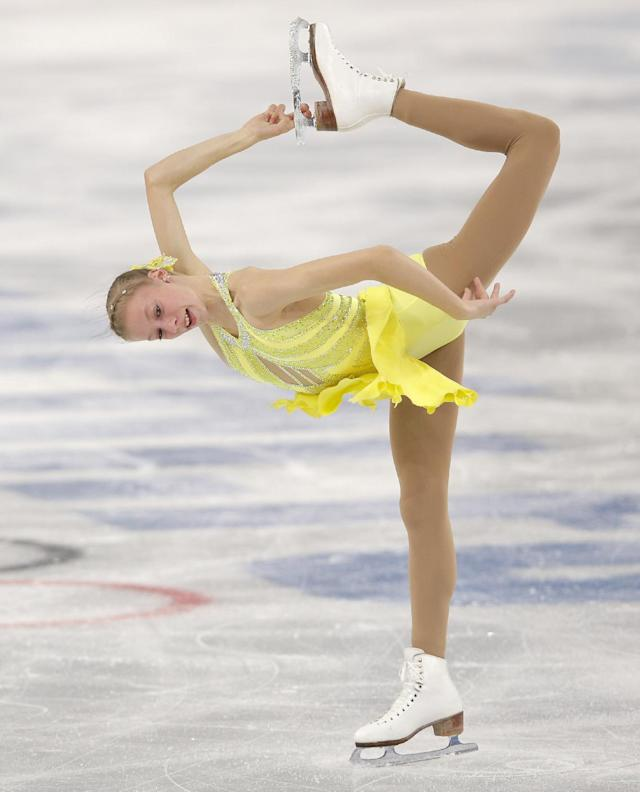 Polina Edmunds of the United States competes in the women's short program figure skating competition at the Iceberg Skating Palace during the 2014 Winter Olympics, Wednesday, Feb. 19, 2014, in Sochi, Russia. (AP Photo/Vadim Ghirda)