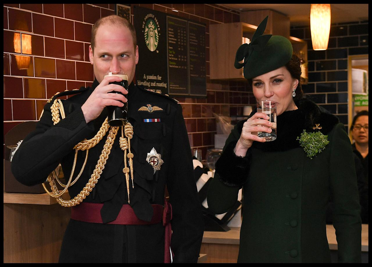 REFILE - CORRECTING DRINK TYPE Britain's Catherine, Duchess of Cambridge drinks sparkling water and Prince William drinks Guinness as they attend the presentation of Shamrock to the 1st Battalion Irish Guards, at a St Patrick's Day parade at Cavalry Barracks in Hounslow, London, Britain March 17, 2018.  Andrew Parsons/Pool via Reuters