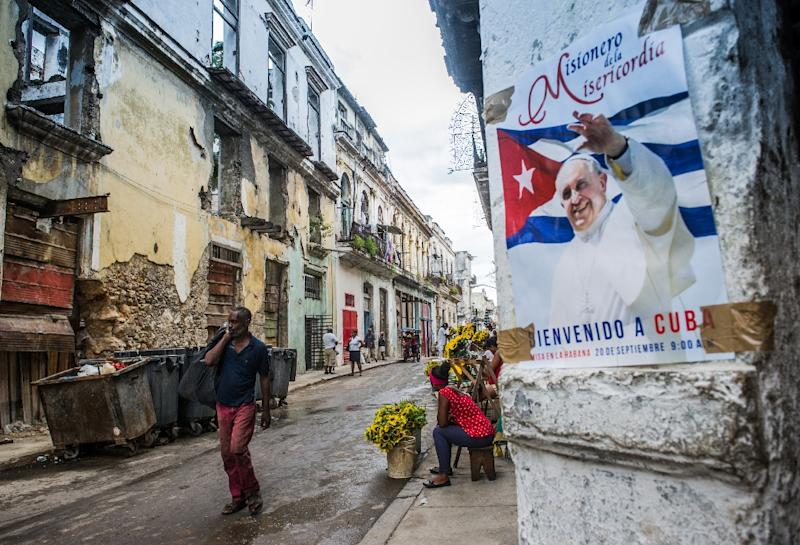 View of a poster of Pope Francis in Havana, on August 30, 2015 as Cuba readies for the pontiff's visit (AFP Photo/Yamil Lage)