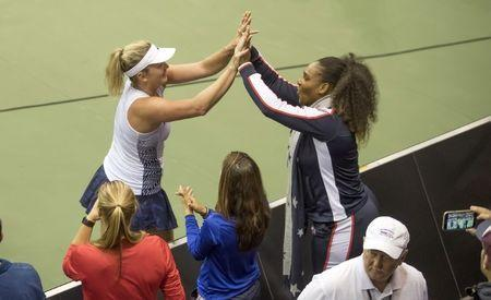 Feb 10, 2018; Asheville, NC, USA; Coco Vandeweghe (USA) celebrates with Serena Williams (USA) after recording match point during her match against Richel Hogenkamp, (NED, not pictured) in their match during the Fed Cup tie at U.S. Cellular Center. Mandatory Credit: Susan Mullane-USA TODAY Sports