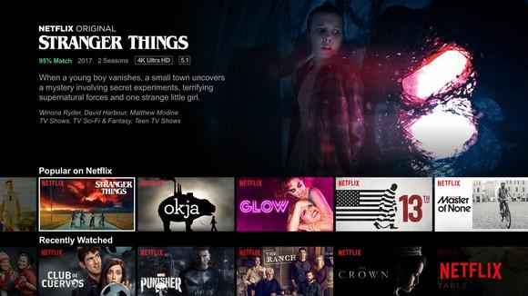 A screenshot of Netflix's home screen shows different show options, including a banner ad for its hit show