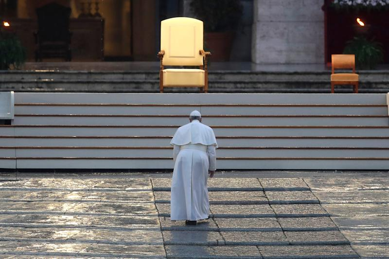 Pope Francis arrives to deliver an Urbi et orbi prayer from the empty St. Peter's Square.