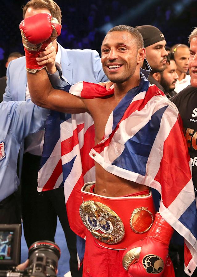 LOS ANGELES, CA - AUGUST 16: Kell Brook poses with his belt and flag after getting the decision over Shawn Porter in their IBF Welterweight World Championship fight at StubHub Center on August 16, 2014 in Los Angeles, California. Stephen Dunn/Getty Images/AFP (AFP Photo/STEPHEN DUNN)