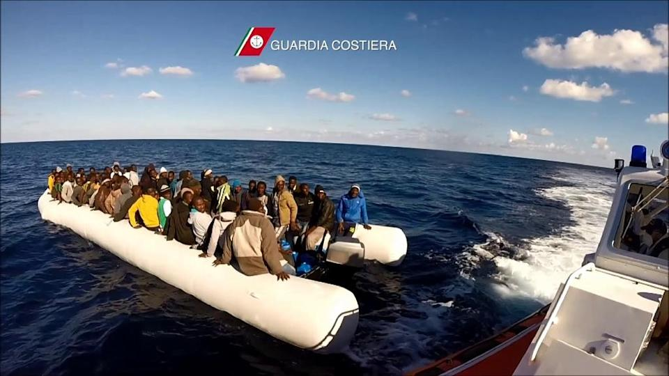 In this video grab released by the Italian Coast Guards (Guardia Costiera) on December 24, 2015 migrants and refugees sit in a boat during a rescue operation, off the coast of Sicily (AFP Photo/-)