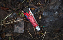 Used toothpaste of a deceased COVID-19 victim lies in a cremation ground in Gauhati, India, Friday, July 2, 2021. The personal belongings of cremated COVID-19 victims lie strewn around the grounds of the Ulubari cremation ground in Gauhati, the biggest city in India's remote northeast. It's a fundamental change from the rites and traditions that surround death in the Hindu religion. And, perhaps, also reflects the grim fears grieving people shaken by the deaths of their loved ones — have of the virus in India, where more than 405,000 people have died. (AP Photo/Anupam Nath)