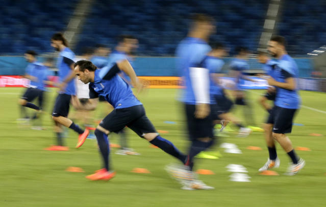 Greece's players work out during a training session of Greece at Arena das Dunas in Natal, Brazil, Wednesday, June 18, 2014. Greece play in group C of the 2014 soccer World Cup. (AP Photo/Shuji Kajiyama)