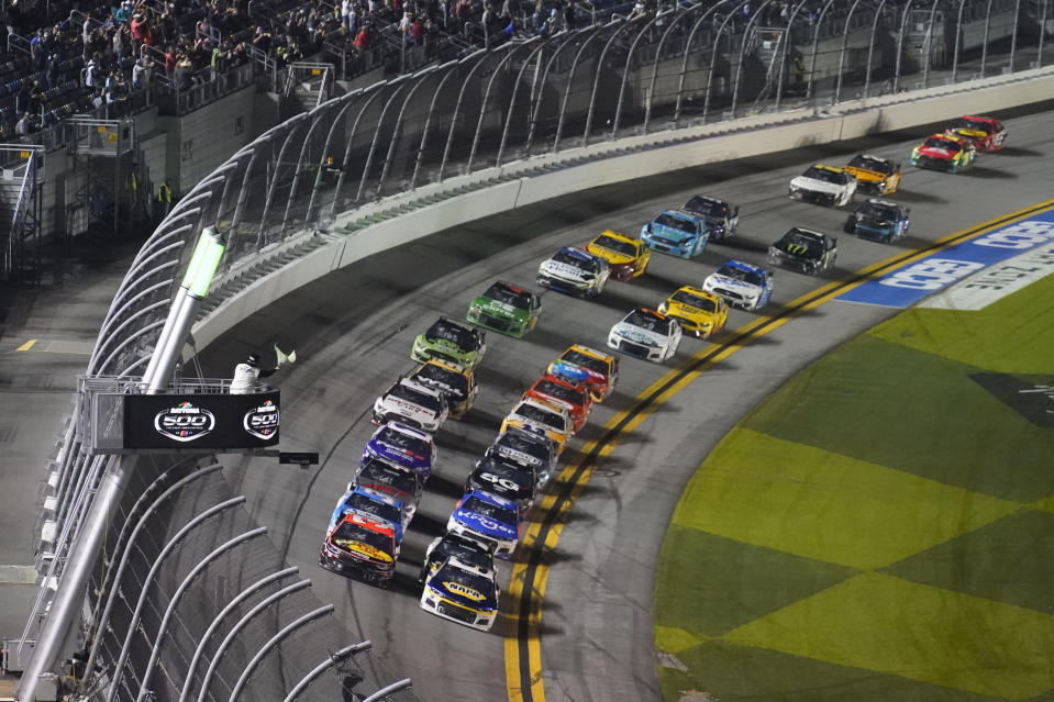 Drivers restart after a weather delay during the NASCAR Daytona 500 auto race at Daytona International Speedway, Sunday, Feb. 14, 2021, in Daytona Beach, Fla. (AP Photo/Chris O'Meara)