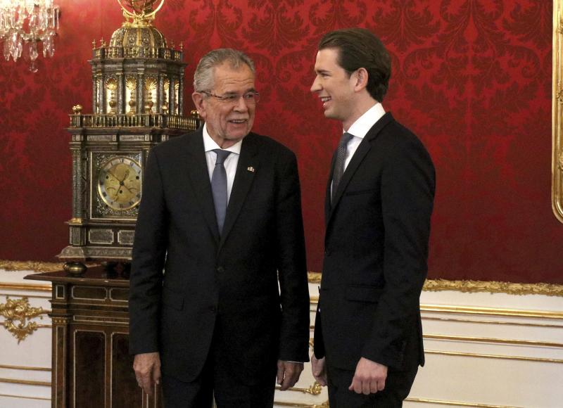 Austrian President Alexander van der Bellen welcomes Foreign Minister Sebastian Kurz, from left, for talks following Sunday's election at the Hofburg palace in Vienna, Austria, Friday, Oct. 20, 2017. Kurz will get the order for forming a new government by the president. (AP Photo/Ronald Zak)