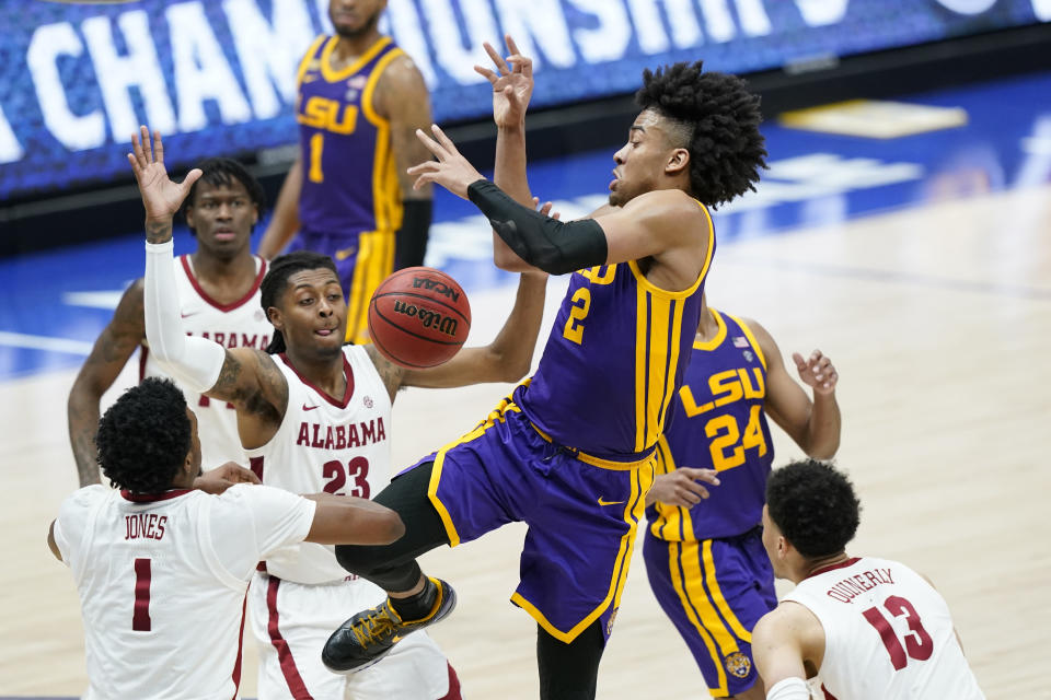 LSU's Trendon Watford (2) loses the ball as he drives against Alabama during the second half of the championship game at the NCAA college basketball Southeastern Conference Tournament Sunday, March 14, 2021, in Nashville, Tenn. (AP Photo/Mark Humphrey)