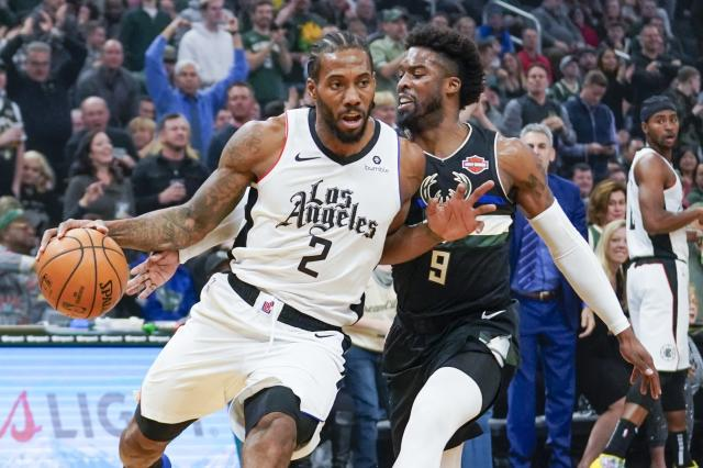 Los Angeles Clippers' Kawhi Leonard drives past Milwaukee Bucks' Wesley Matthews during the first half of an NBA basketball game Friday, Dec. 6, 2019, in Milwaukee. (AP Photo/Morry Gash)