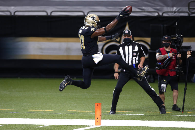 New Orleans Saints tight end Jared Cook (87) leaps into the end zone on a touchdown reception. (AP Photo/Butch Dill)