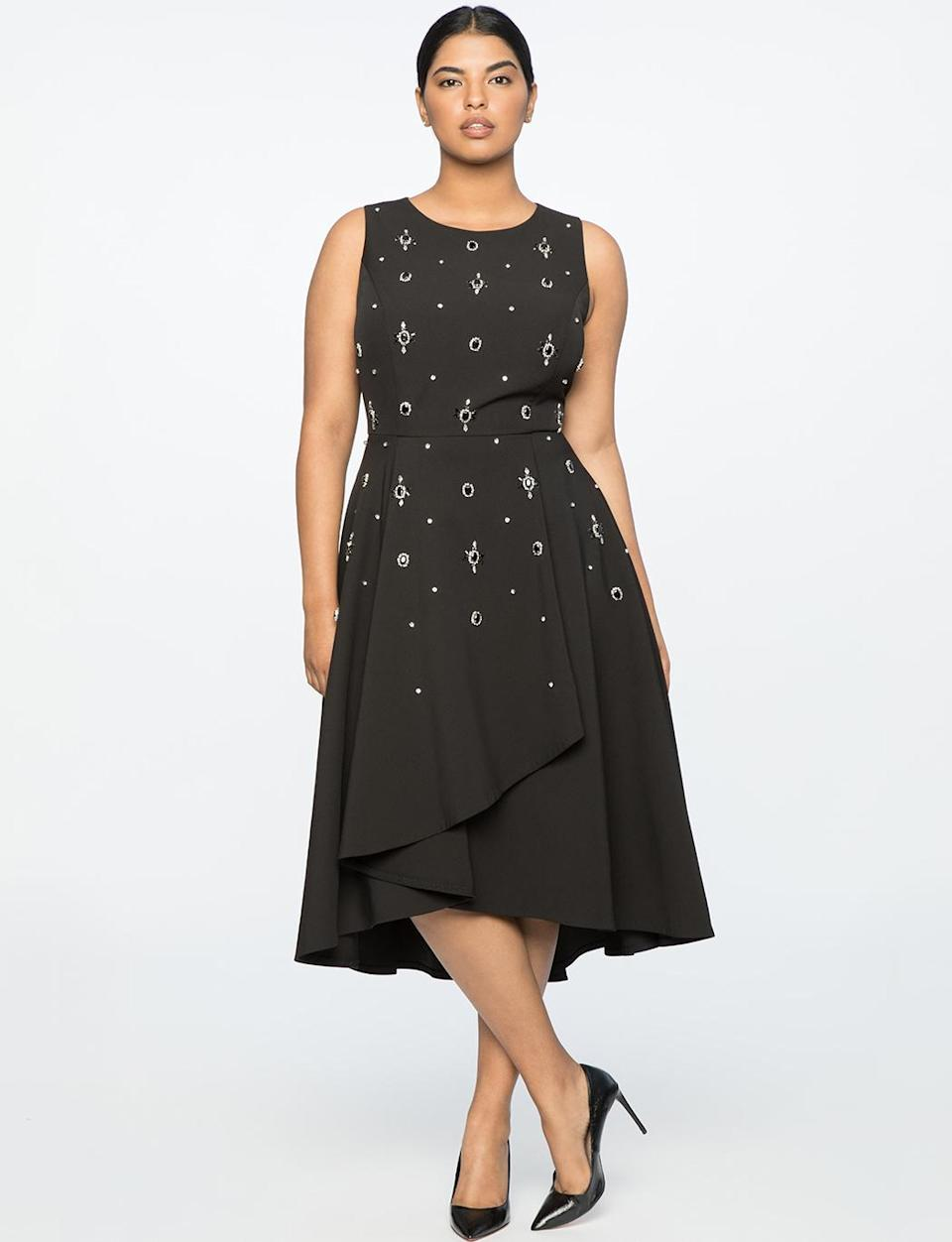 """<p>If you always have trouble finding a dress to wear at your office holiday party, this dress checks all the boxes and won't disappoint. It features a conservative neckline, a feminine flare midi-length hem, and tiny crystal embellishments that will get you in the holiday spirit. We suggest adding a faux-fur stole and chandalier earrings to complete the outfit.<br>Crepe-embellished fit-and-flare dress, $190, <a rel=""""nofollow noopener"""" href=""""https://fave.co/2qjnHHg"""" target=""""_blank"""" data-ylk=""""slk:eloquii.com"""" class=""""link rapid-noclick-resp"""">eloquii.com</a> </p>"""