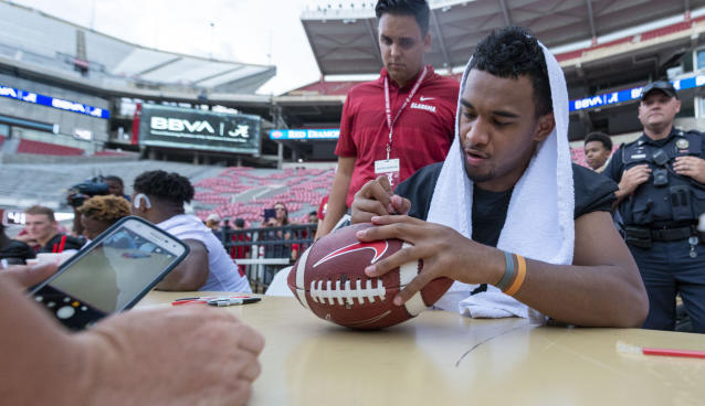 College athletes will soon be able to profit off things like signing footballs. (AP)