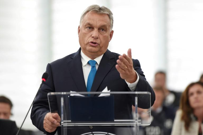 "Hungarian Prime Minister Viktor Orban vowed Tuesday he would resist and attempt to ""blackmail"" it into softening its anti-migrant stance"