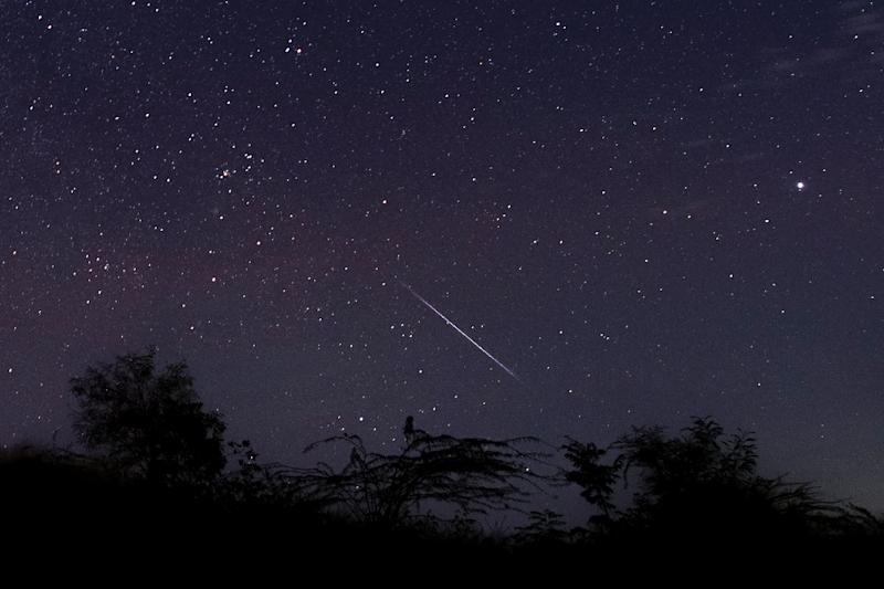A meteor streaking through the night sky over Myanmar during the Geminid meteor shower on December 14 2018