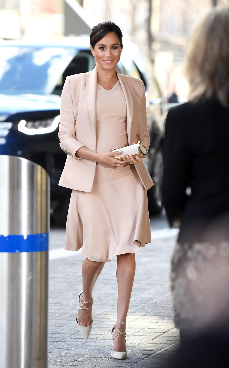 Demonstrating how to wear SS19's biggest trend, the royal wore a powder pink dress and co-ordinating blazer by Brandon Maxwell. To accessorise the tonal ensemble, the royal chose a Carolina Herrera clutch bag with lace-up Aquazurra heels - which she first wore on her engagement photo call. <em>[Photo: Getty]</em>