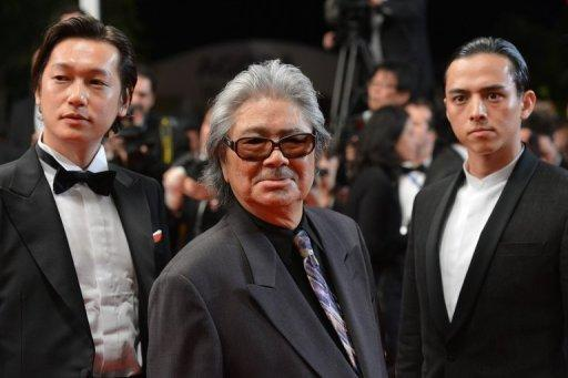 """(L-R) Japanese actor Hideo Nakaizumi, director Koji Wakamatsu and actor Arata Iura arrive for the screening of """"11.25 The Day He Chose His Own Fate"""" at the Cannes film festival in May. """"Only commercial films are being supported by government funds in Asia so young filmmakers are only making commercial films,"""" said Wakamatsu"""