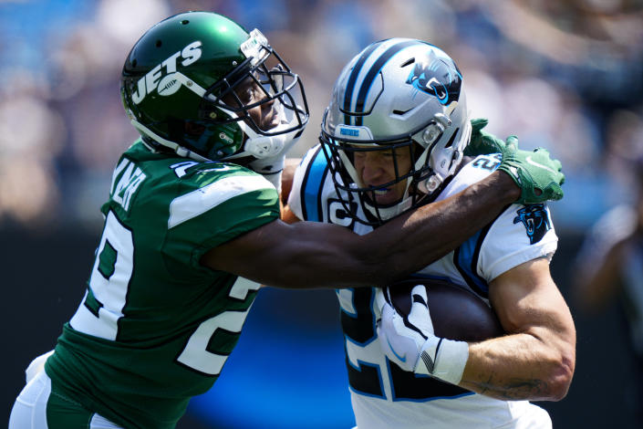 Carolina Panthers running back Christian McCaffrey is tackled by New York Jets free safety Lamarcus Joyner during the first half of an NFL football game Sunday, Sept. 12, 2021, in Charlotte, N.C. (AP Photo/Jacob Kupferman)