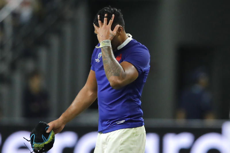 France's Sebastien Vahaamahina leaves the field after receiving a red card during the Rugby World Cup quarterfinal match at Oita Stadium in Oita, Japan, Sunday, Oct. 20, 2019. (AP Photo/Christophe Ena)