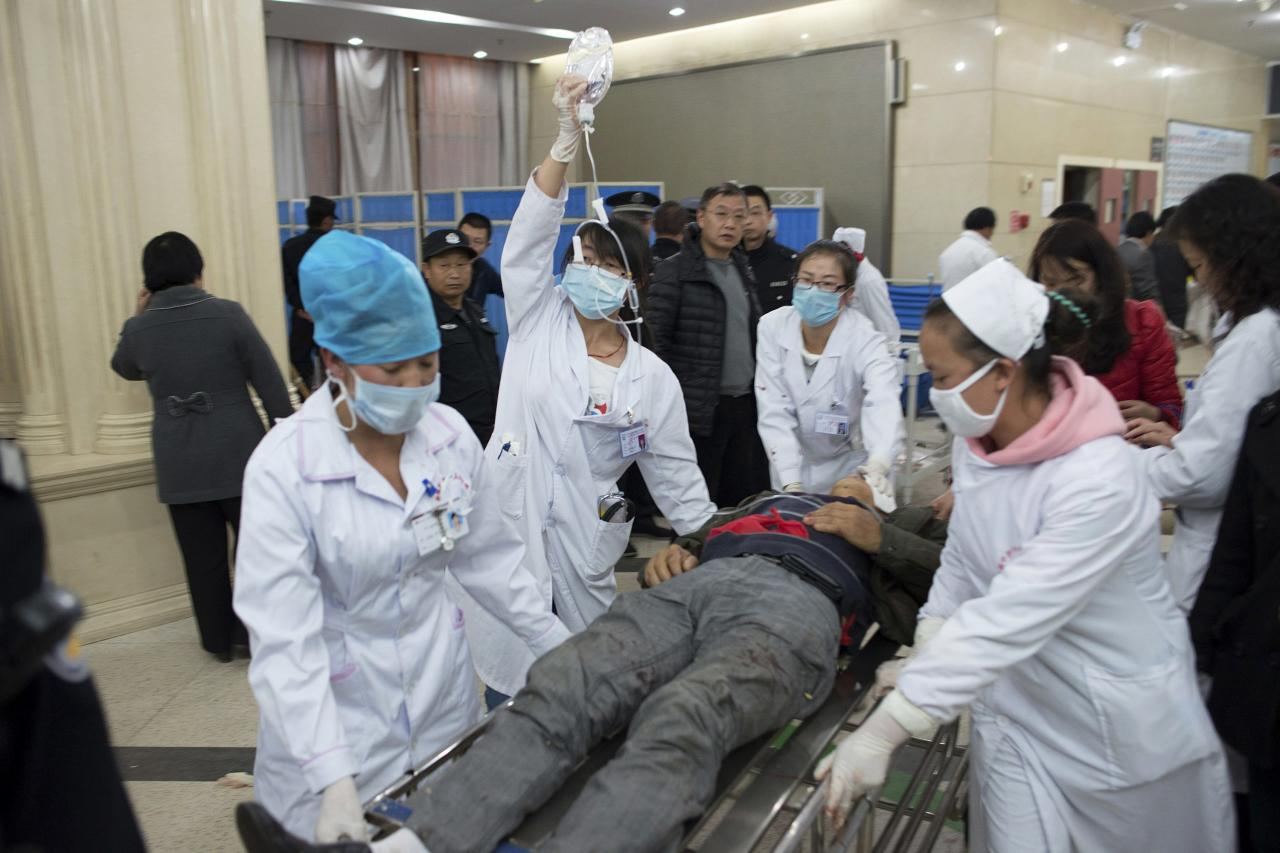 An injured man is pushed at a hospital after a knife attack at Kunming railway station, Yunnan province, March 1, 2014. Witnesses to chilling violence at a Chinese train station placed under heavy security on Sunday recalled moments of fear and chaos after at least 29 people were killed in what authorities called a terrorist attack by Xinjiang militants. Picture taken March 1, 2014. REUTERS/Stringer (CHINA - Tags: CIVIL UNREST CRIME LAW) CHINA OUT. NO COMMERCIAL OR EDITORIAL SALES IN CHINA