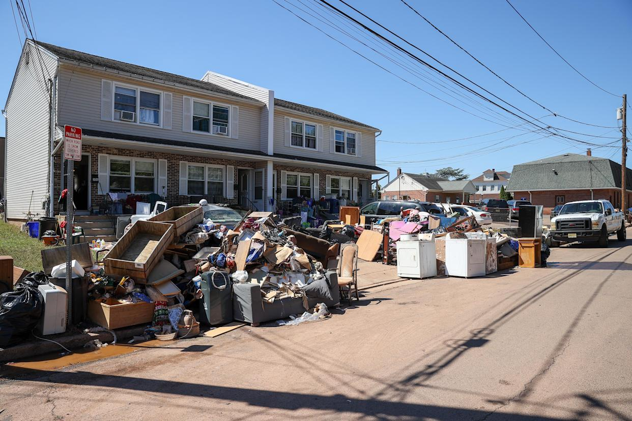 Residents in Manville, N.J., left their belongings on the sidewalk after heavy rain from Hurricane Ida on Tuesday.
