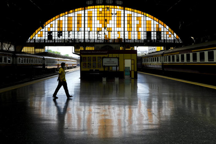 A worker wearing a face mask to help curb the spread of the coronavirus walks across the platform at the 104-year-old Hua Lamphong Railway Station in Bangkok, Thailand, Tuesday, July 20, 2021. (AP Photo/Sakchai Lalit)