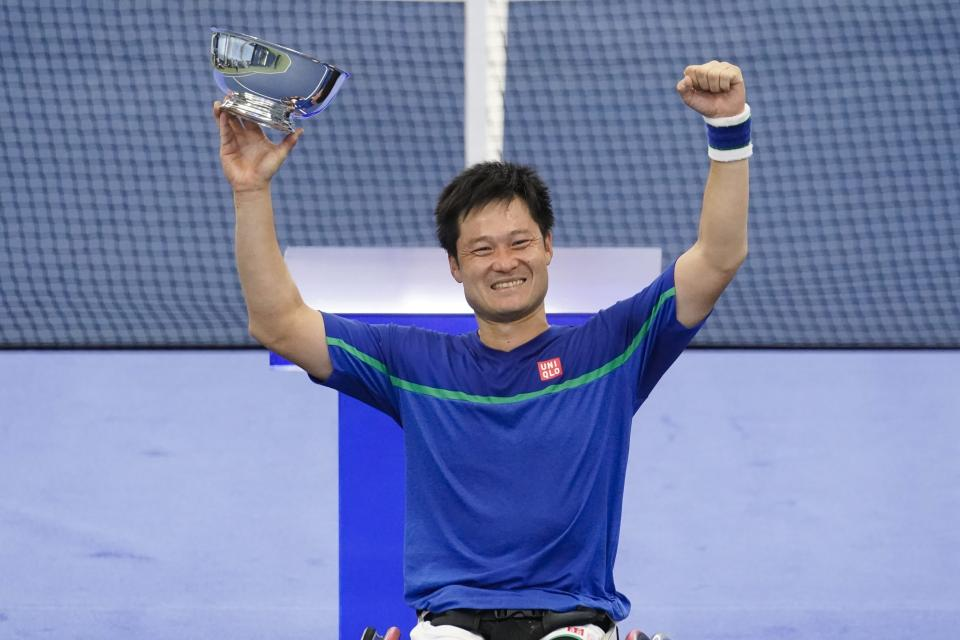 Japan's Shingo Kunieda holds the championship trophy after defeating Alfie Hewett, of the United Kingdom, in the final of the US Open tennis championships Sunday, Sept. 13, 2020, in New York.(AP Photo/Frank Franklin II)
