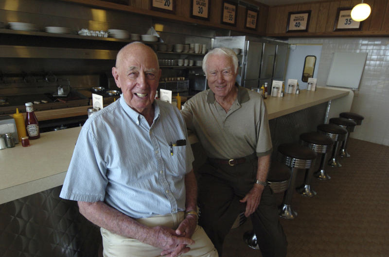 FILE - In this file photo taken Aug. 25, 2008, Waffle House Founders Joe Rogers Sr., left, and Tom Forkner Sr. pose at the company's museum located on the site of the first Waffle House in Avondale Estates, Ga. Forkner, who jumped from real estate to the restaurant business when he co-founded Waffle House in the 1950s, has died weeks after the death of his business partner who helped him create the famous Southern diner chain. Waffle House said in a statement that Forkner died Wednesday, April 26, 2017, at age 98. (Frank Niemeir/Atlanta Journal-Constitution via AP, File)