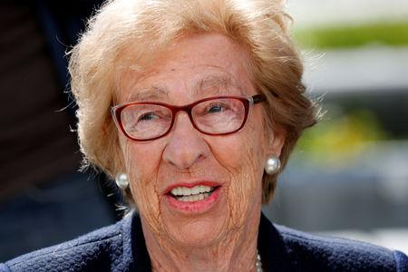 Auschwitz survivor Eva Schloss, stepsister of Holocaust diarist Anne Frank, listens to Chabad Rabbi Reuven Mintz  at Newport Harbor High School after speaking with a group of students seen in viral online photos giving Nazi salutes over a swastika made of red cups that sparked outrage in Newport Beach, California, U.S., March 7, 2019. REUTERS/Mike Blake