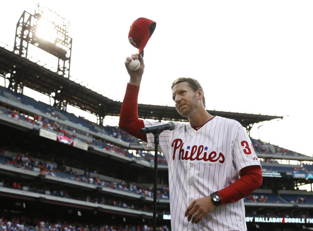 In this Aug. 8, 2014, file photo, Roy Halladay acknowledges the Philadelphia crowd. (AP)