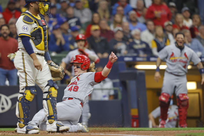 St. Louis Cardinals' Harrison Bader scores from second base on Cardinals' Tommy Edman fly out during the second inning of a baseball game against the Milwaukee Brewers Wednesday, Sept. 22, 2021, in Milwaukee. (AP Photo/Jeffrey Phelps)