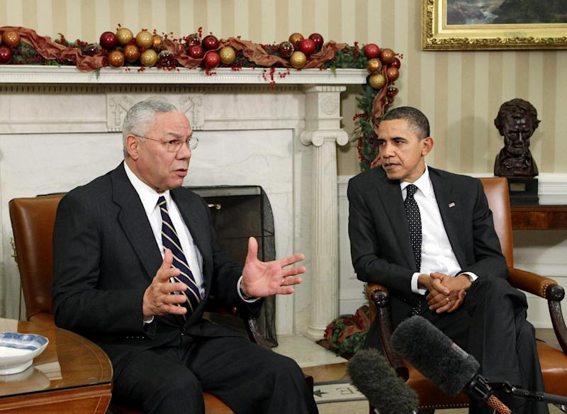 "FILE - In this Dec. 1, 2010 file photo, former Secretary of State Colin Powell meets with President Barack Obama, in the Oval Office at the White in Washington. Powell, a longtime Republican said on the ""CBS This Morning"" program Thursday, he is sticking with President Barack Obama in this year's election.  (AP Photo/J. Scott Applewhite, File)"