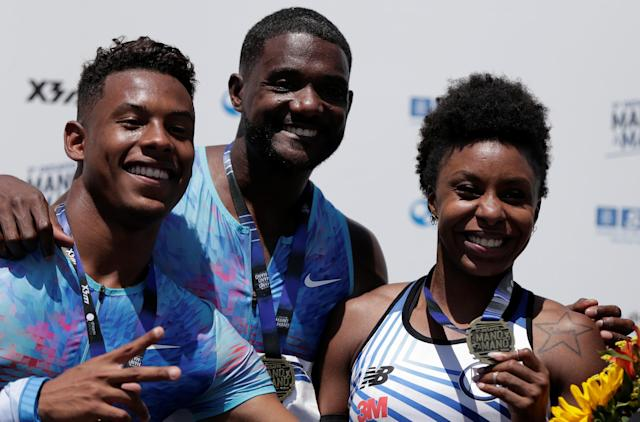"Paulo Andre de Oliveira of Brazil (L), Justin Gatlin of the U.S. (C), and Rosangela Santos of Brazil pose at the medal ceremony during the ""Mano a Mano"" challenge, a 100-meter race, at the Brazilian Jockey Club in Rio de Janeiro, Brazil October 1, 2017. REUTERS/Bruno Kelly"