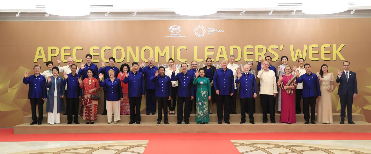 <p>Leaders and their spouses pose for a family photo ahead of the Asia-Pacific Economic Cooperation (APEC) Summit leaders gala dinner in the central Vietnamese city of Danang on Nov. 10, 2017. (Photo: STR/Vietnam News Agency/AFP/Getty Images) </p>