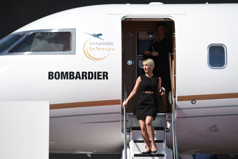 FILE PHOTO: An attendee exits the Bombardier Global 6500 business jet at the National Business Aviation Association (NBAA) exhibition in Las Vegas