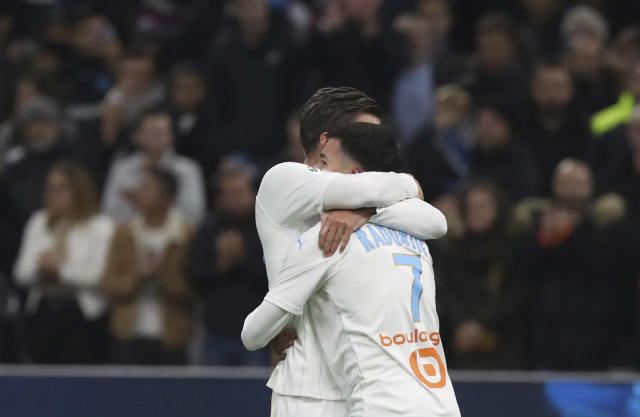 Marseille's Kevin Strootman, left, and Marseille's Nemanja Radonjic celebrate their victory after the French League One soccer match between Marseille and Brest at the Velodrome stadium in Marseille, southern France, Friday, Nov. 29, 2019. (AP Photo/Daniel Cole)