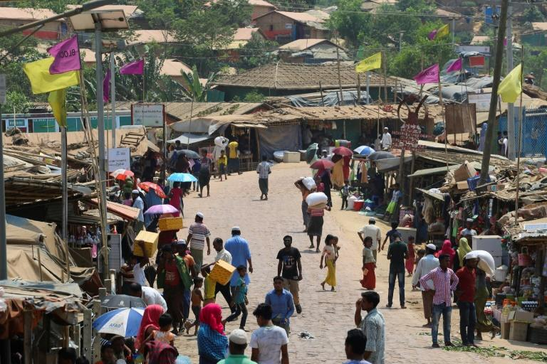 Rohingya refugees gather in a market area in the Kutupalong Rohingya refugee camp in March 2020
