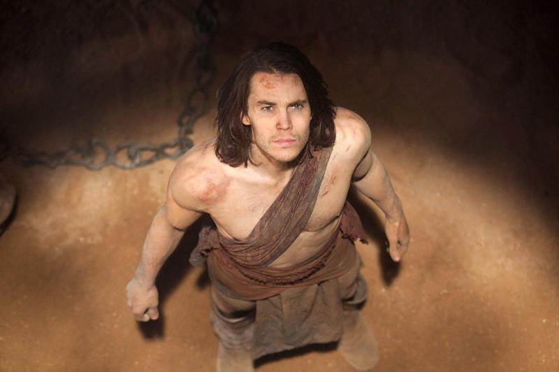 """In this film image released by Disney, Taylor Kitsch is shown in a scene from """"John Carter."""" (AP Photo/Disney, Frank Connor)"""