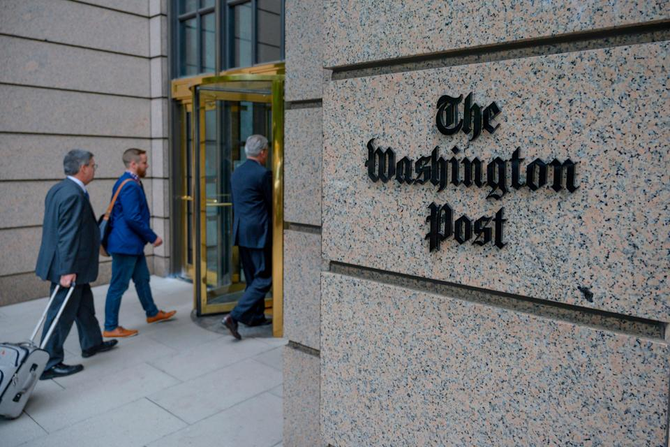 <p>The building of the Washington Post newspaper headquarter is seen on K Street in Washington DC on May 16, 2019. </p> ((Photo by ERIC BARADAT/AFP via Getty Images))