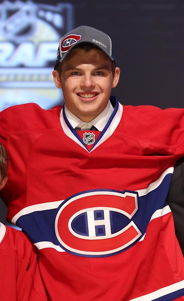 PITTSBURGH, PA - JUNE 22: Alex Galchenyuk, third overall pick by the Montreal Canadiens, poses on stage during Round One of the 2012 NHL Entry Draft at Consol Energy Center on June 22, 2012 in Pittsburgh, Pennsylvania.  (Photo by Bruce Bennett/Getty Images)